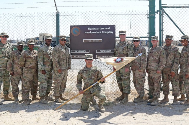 Maj. David Leiva and 1st Sgt. Darren Rone, Headquarters Company command team, 184th Sustainment Command, stand with their Soldiers at Camp Arifjan, Kuwait, July 9, 2019.  (U.S. Army National Guard photo by Sgt. Connie Jones)