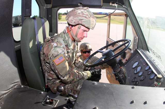 Patriot Fire Control Enhanced Operator/Maintainer AIT students Pvt. John Miller (at wheel), and Pvt. Kodi Keup, get familiar with the controls of a Heavy Expanded Mobility Tactical Truck tractor. The HEMTT is used to transport some of the equipment the students will use as MOS 14E Soldiers.