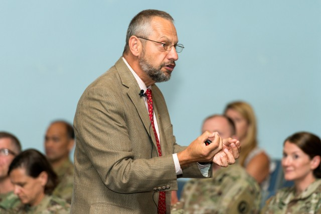 Dr. Boris D. Lushniak, dean and professor, school of public health, University of Maryland offers a dynamic discussion of infectious disease disasters during a plenary session of the fourth annual Army Public Health Course at Joint Base McGuire Dix Lakehurst New Jersey, July 30, 2019. The 2019 Army Public Health Course brings public health professionals from around the world together for training on emerging public health topics. (U.S. Army photo by Graham Snodgrass).