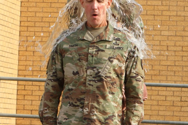 Brig. Gen. Stephen Smith, Field Artillery School commandant and chief of FA, receives his ice bucket challenge dousing during a change of responsibility ceremony for the chief warrant officer of the Field Artillery Branch, Aug. 2, 2019, at Fort Sill, Okla. Smith accepted the challenge from outgoing field artillery CWO5 John Robinson, who retired after 30 years of service and revealed he has Lou Gehrig's Disease.