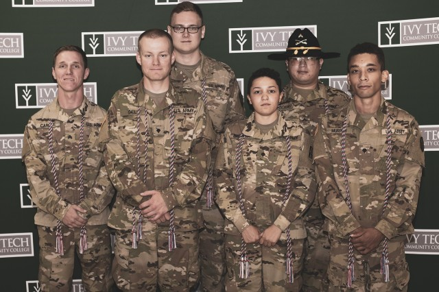 Indiana National Guard Soldiers graduate from the Ivy Tech Community College Cyber Academy on August 2, 2019. Front Row: Sgt. Stephen Carlile, 76th Infantry Brigade Combat Team; Spc. James Gill, 2/150 Field Artillery; Spc. Sophia Balderas, 76th Brigade Engineer Battalion; Spc. Caleb Murphy, 151 Heavy Infantry, D Co. Back Row: Spc. Nathaniel Musick, 219th Engineering Brigade; Cpl. Luis Diaz-Sanchez, 1/152 Cav.