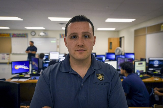 1st Lt. Conner Wissmann, 781st Military Intelligence Battalion cyberspace operations officer, mentors local students at Meade Senior High School, at Fort Meade, Md., Aug. 7, 2019. Wissmann, along with his partners from USCYBERCOM and NSA, volunteered their time to educate students during a two-week Cyber Security Summer Camp at the school.