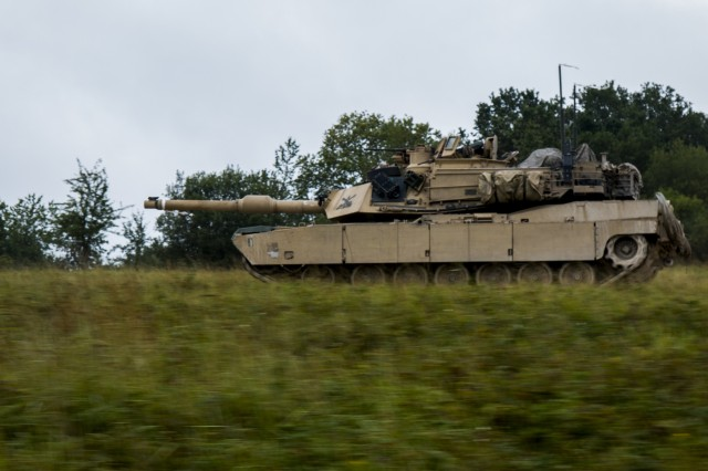 M1A2 Abram tank Troops drive down the road during a Combined Resolve training exercise in Grafenwoehr Training Area, August, 8, 2019. Combined Resolve XII at the Joint Multinational Readiness Center (JMRC) is the final exercise in 1-1 Infantry Division's rotation in support of Atlantic Resolve in Europe, which evaluates the interoperability of U.S. Forces with their NATO allies and partners. (U.S. Army photo by Pfc. Zack Stahlberg)
