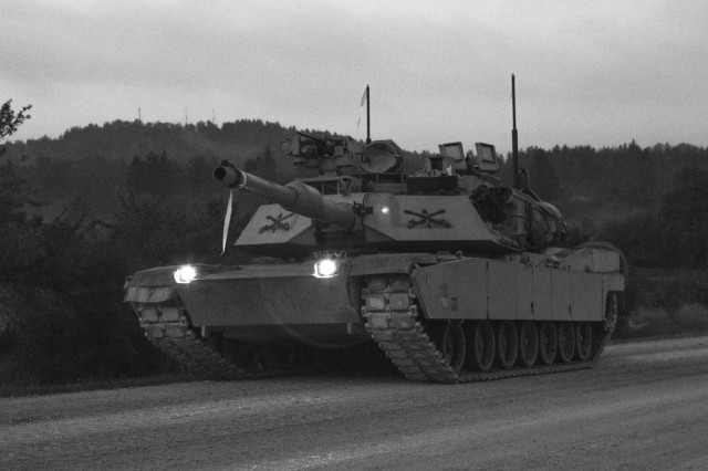 M1A2 Abram tank Troops drive down the road during a Combined Resolve training exercise in Grafenwoehr Training Area, August, 8, 2019. Combined Resolve XII at the Joint Multinational Readiness Center is the final exercise in 1-1 Infantry Division's rotation in support of Atlantic Resolve in Europe, which evaluates the interoperability of U.S. Forces with their NATO allies and partners. (U.S. Army photo by Pfc. Zack Stahlberg)