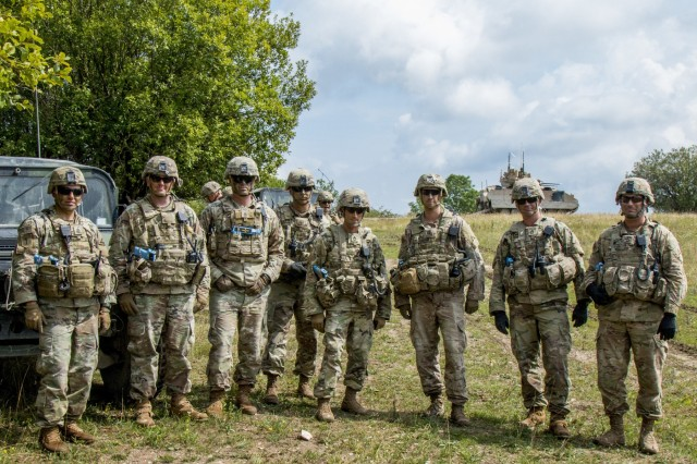 Observer Controller Trainers assigned to the Joint Multinational Readiness Center (JMRC) pose for a picture during a Combined Resolve training exercise in Grafenwoehr Training Area, August, 8, 2019. Combined Resolve XII at the JMRC is the final exercise in 1-1 Infantry Division's rotation in support of Atlantic Resolve in Europe, which evaluates the interoperability of U.S. Forces with their NATO allies and partners.(U.S. Army photo by Pfc. Zack Stahlberg)