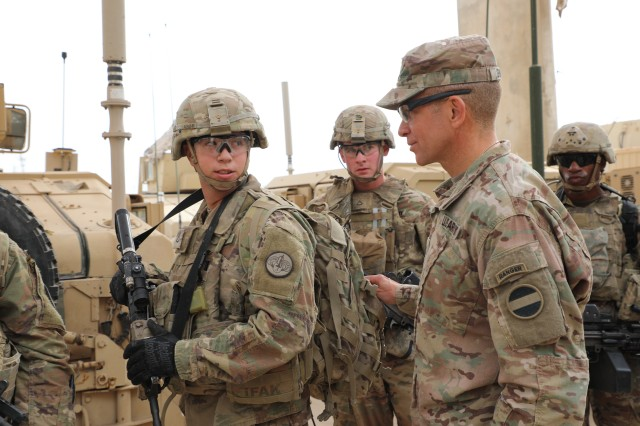 Command Sgt. Maj. Michael Grinston, right, senior enlisted leader for Army Forces Command, speaks about the importance of having the correct gear and equipment to accomplish the mission Nov. 19, 2018, in Baghdad, Iraq. Grinston was sworn in as the 16th sergeant major of the Army on Aug. 9, 2019. As the top enlisted leader in the Army, one of his priorities will be for Soldiers to master the fundamentals -- the basic individual combat tasks and skills they should all know.
