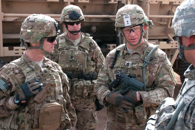 Command Sgt. Maj. Michael A. Grinston, center right, senior enlisted leader for 1st Infantry Division, provides feedback to a Soldier during a visit to Al Asad Air Base, Iraq, Feb. 11, 2015. Grinston was sworn in as the 16th sergeant major of the Army on Aug. 9, 2019. As the top enlisted leader in the Army, one of his priorities will be for Soldiers to master the fundamentals -- the basic individual combat tasks and skills they should all know.