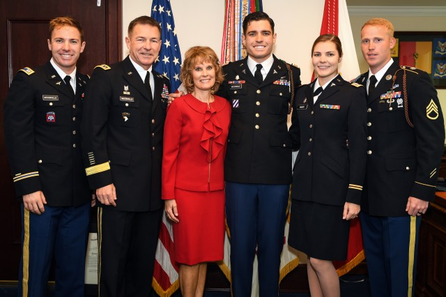 The family of Gen. James McConville poses for a photo during a promotion ceremony in honor of his son, Capt. Ryan McConville, in his office at the Pentagon in Arlington, Va., May 2, 2019. McConville, who was sworn in as the Army's 40th chief of staff on Aug. 9, 2019, said he plans to put people -- Soldiers, Army civilians and family members -- first as he ensures the Army is ready to fight now while at the same time being modernized for the future fight.