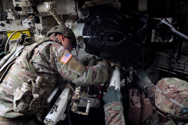 """CAMP HOVEY, Republic of Korea - Soldiers with C Battery, 2nd Battalion, 82nd Field Artillery Regiment, 3rd Armored Brigade Combat Team """"Greywolf"""", 1st Cavalry Division, disassemble a breech in a Paladin self-propelled Howitzer during Sergeant's Time Training, July 25. The Greywolf Brigade is in Korea as part of the normal rotation of forces to support U.S. Allies on the peninsula. (U.S. Army photo by Capt. Scott Kuhn, 3rd Armored Brigade Combat Team, 1st Cavalry Division Public Affairs)"""