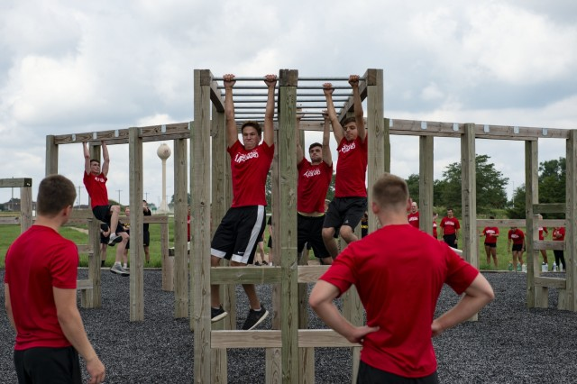 Trainees from the Nebraska Air National Guard's student flight complete one of the four obstacles while competing against the Nebraska Army National Guard's Recruit Sustainment Program Aug. 3, 2019 at the Army National Guard's Greenlief Training Site near Hastings, Nebraska. At the end of the challenge, Nebraska Air National Guard student flight won by just a point. (U.S. Air Force photo taken by Senior Airman Jamie Titus)