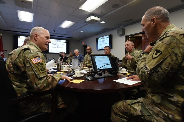 Maj. Gen. John Evans Jr. (left), commanding general of U.S. Army Cadet Command and Fort Knox, discusses some issues with Gen. Gus Perna (right), commander of U.S. Army Materiel Command, Aug. 8, 2019.