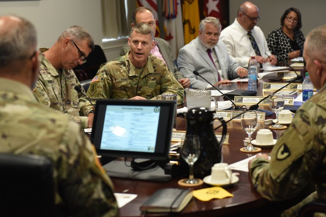 Col. CJ King, commander of U.S. Army Garrison at Fort Knox, briefs Gen. Gus Perna, commanding general of U.S. Army Materiel Command, Aug. 8, 2019, about some of the installation's achievements and issues leaders are working on.