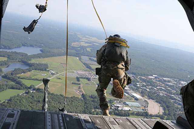 An airborne Soldier participating in the Leapfest International Airborne Competition in South Kingstown, Rhode Island exists a CH-47 flown by Soldiers from the New York Army National Guard's Bravo Company, 3rd Battalion, 126th Aviation from 1,500 feet in the air heading for his target. Soldiers from Bravo Company, 3rd Battalion, 126th Aviation, based in Rochester, N.Y. have been providing support to the Rhode Island National Guard's Leapfest competition since 2011.