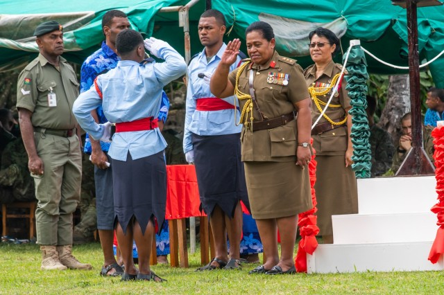 A student cadet salutes with award in hand that he received from Fijian Col. Litea Seruiratu, who serves as director of human resources for the Republic of Fiji Military Forces, during a cadet graduation at the Napuka Secondary School in Napuka Village, Fiji, Aug. 7, 2019. U.S. and Fijian Soldiers attended the event and did a tactics display for the event to showcase the jungle training done during Exercise Cartwheel 2019. Exercise Cartwheel is a U.S. Army Pacific sponsored military training, and community engagement event under the Pacific Pathways program. The exercise demonstrates the U.S. Army's enduring commitments to Fiji, and promotes cooperation and interoperability with our partners in a free and open Indo-Pacific. (U.S. Army photo by Sgt. 1st Class Whitney Houston)