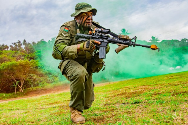 Lance Corporal Nabala Rua, who serves with 3rd Battalion, Fiji Infantry Regiment, rushes during a flanking maneuver demonstration at a cadet graduation in Napuka Village, Aug. 7, 2019. The 1st Battalion, 27th Infantry Regiment, 2nd Brigade, Inf. Brig. Combat Team, 25th Inf. Division and Fijian 3rd FIR Soldiers attended the event to showcase the jungle training exercise done during Exercise Cartwheel 2019. Bilateral training develops the RFMF capabilities and increased the strength and security of both military forces for a free and open Indo-Pacific region.