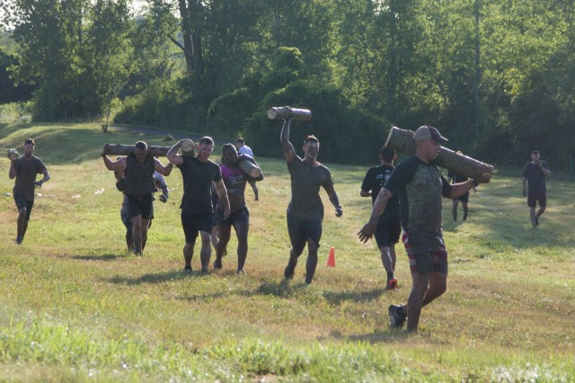 Soldiers and family members from the 10th Mountain Division (LI) participate in the annual Mountain Mudder obstacle course throughout Fort Drum on Aug. 9. (U.S. Army photo by Pfc. Tiffany Banks)