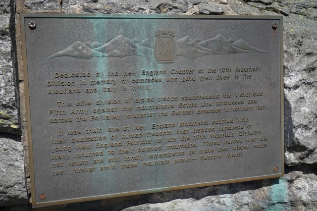 A plaque recognizing the 10th Mountain Division Soldiers who fought and died during World War II at the summit of Mount Washington, New Hampshire Aug. 6, 2019.