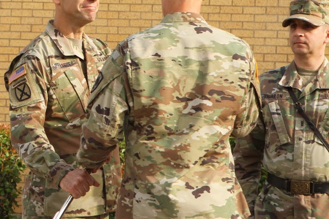 Chief Warrant Officer 5 Steve Pressley receives the saber from Brig. Gen. Stephen Smith, Field Artillery School commandant and chief of FA, Aug. 2, 2019, during a change of responsibility ceremony in front of I-See-O Hall at Fort Sill, Okla. Pressley became the fourth CWO5 of field artillery, a position that advises the commandant on all matters related to warrant officers in the FA branch.