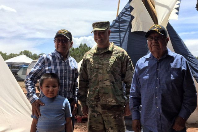 Col. Chris Ward poses with members of the Mescalero Apache Tribe during the Oscura Blessing Ceremony held last weekend at White Sands Missile Range.