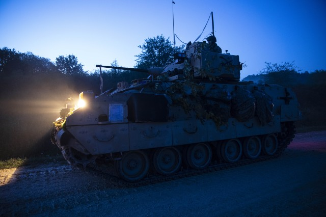 A U.S. Army Bradley Fighting Vehicle with 1st Squadron, 4th Cavalry Regiment, 1st Armored Brigade Combat Team, 1st Infantry Division, is staged and ready to roll out early in the morning to a live fire range at the Grafenwoehr Training Area, Germany, August 8, 2019. The 1-4 CAV is participating in Combined Resolve XII, a multinational exercise designed to increase the readiness of allied forces during Atlantic Resolve. (U.S. Army photo by Sgt. Thomas Mort)