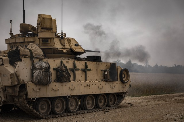 A U.S. Army Bradley Fighting Vehicle with 1st Squadron, 4th Cavalry Regiment, 1st Armored Brigade Combat Team, 1st Infantry Division, fires rounds during a live fire range at the Grafenwoehr Training Area, Germany, August 8, 2019. The 1-4 CAV is participating in Combined Resolve XII, a multinational exercise designed to increase the readiness of allied forces during Atlantic Resolve. (U.S. Army photo by Sgt. Thomas Mort)