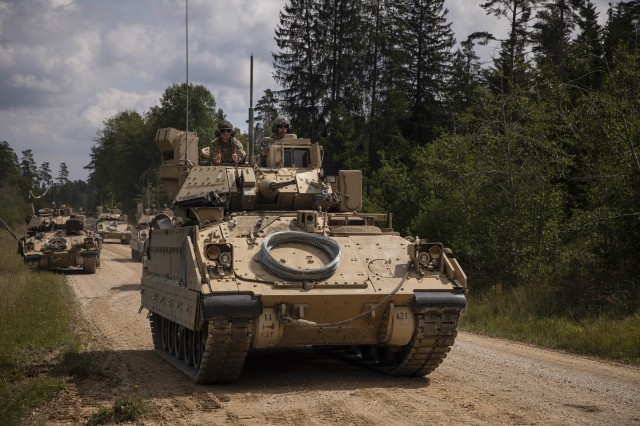 U.S. Army Bradley Fighting Vehicles with 1st Squadron, 4th Cavalry Regiment, 1st Armored Brigade Combat Team, 1st Infantry Division, return from a live fire exercise at the Grafenwoehr Training Area, Germany, August 8, 2019. The 1-4 CAV is participating in Combined Resolve XII, a multinational exercise designed to increase the readiness of allied forces during Atlantic Resolve. (U.S. Army photo by Sgt. Thomas Mort)