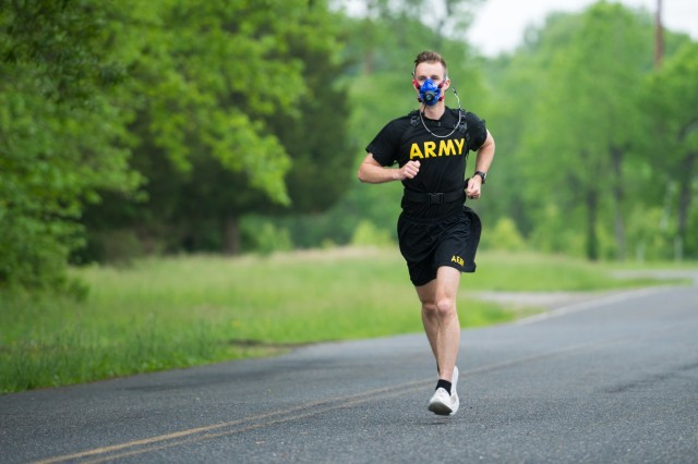U.S. Army Capt. Zachary Schroeder, Headquarters and Headquarters Company commander, Army Public Health Center, runs with the new K5 metabolic testing unit May 9, 2019, as part of his training to compete in the Army Ten Miler in October 2019. The K5 portable VO2 unit, which is available at certain Army Wellness Center locations, allows Soldiers and athletes to measure how well their muscles use oxygen, and can be used to optimize performance and train for events. (U.S. Army photo by Graham Snodgrass).