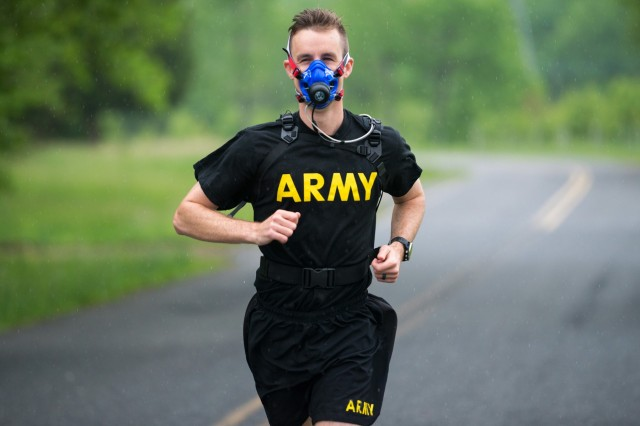 U.S. Army Capt. Zachary Schroeder, Headquarters and Headquarters Company commander, Army Public Health Center, runs with the new K5 metabolic testing unit May 9, 2019 as part of his training to compete in the Army Ten Miler in October 2019. The K5 portable VO2 unit, which is available at certain Army Wellness Center locations, allows Soldiers and athletes to measure how well their muscles use oxygen, and can be used to optimize performance and train for events. (U.S. Army photo by Graham Snodgrass).