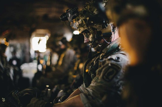 U.S. Army paratroopers assigned to 1st Squadron (Airborne), 91st Cavalry Regiment, 173rd Airborne Brigade ride in a CH-47 Chinook en route to an air assault mission in Hohenfels Training Area, Germany, during Exercise Saber Screen 19, July 22, 2019.