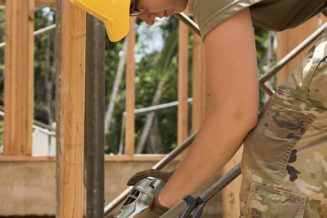 U.S. Army Spc. Breanna Brundige, a carpentry and masonry specialist assigned to the 1156th Engineer Company, 204th Engineer Battalion, New York Army National Guard, operates a nail gun to secure a board into a wall frame during an Innovative Readiness Training (IRT) mission at Camp Paumalu, Haleiwa, HI, July 31, 2019. Engineers from the Air Force, Air National Guard, and the Marine Corps have been working at the camp since May to help build a Science, Technology, Engineering, and Math (STEM) activity center. The IRT is a joint service program that provides real-world training opportunities for the U.S. military's Reserves and National Guard service members to prepare them for wartime missions while supporting the needs of America's underserved communities.