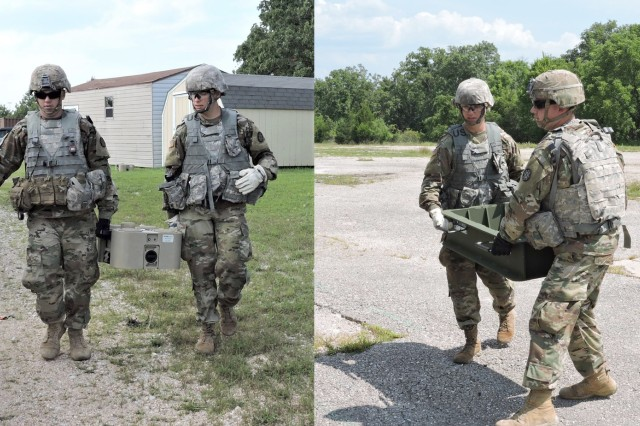 Two Soldiers from the 595th Sapper Company carry Close Terrain Shaping Obstacle prototypes at Training Area 190 on Fort Leonard Wood during a recent Soldier Touch Point event.