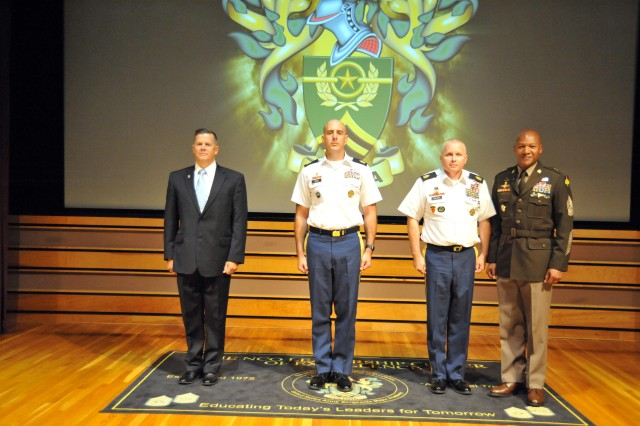 The NCO Leadership Center of Excellence welcomed Sergeants Major Course Class 70 during ceremonies August 9. Above, Command Sgt. Maj. Jimmy Sellers, commandant of the NCOL CoE, took time during the ceremony to recognize three individuals who had met the requirements to be credentialed as assistant professors. Above are (l-r) Dr. Michael Hayes, chair of the Department of Command Leadership; Sgt. Maj. Michael Irvin, chair of the Department of Professional Studies; and Sgt. Maj. Dennis Collins, vice chair of the Department of Joint, interagency, Intergovernmental and Multinational.