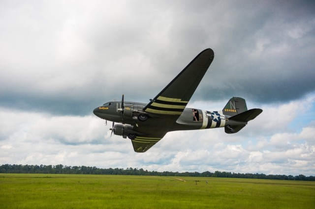 FORT BENNING, Ga. -- In this U.S. Army file photo from 2018, a restored Douglas C-33 aircraft flies low over Fryar Drop Zone as part of National Airborne Day. The Maneuver Center of Excellence and Fort Benning is scheduled to host the 2019 National Airborne Day event beginning 9 a.m. Aug. 16 at Fryar Drop Zone with freefall parachute jump demonstrations by two separate jump teams, followed by a graduation ceremony of the nation's newest paratroopers. (U.S. Army file photo by Patrick Albright, Maneuver Center of Excellence, Fort Benning Public Affairs)