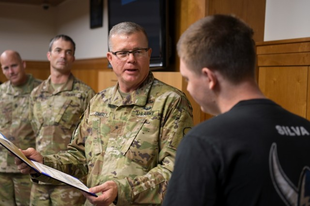 Army Brig. Gen. Mark Simerly, commander of the 19th Expeditionary Sustainment Command, prepares to gift Jacob Silva with a certificate of appreciation at the Camp Carroll Community Activity Center (CAC), Aug. 11, 2019 at Camp Carroll, South Korea. In coordination with the U.S. Army, the Make-A-Wish Foundation organized a party for Silva at the CAC.