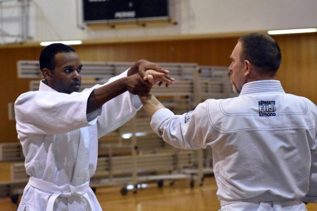 Spc. Norman Maloy, left, assigned to the 35th Combat Sustainment Support Battalion, works on an aikido move with Joe Millen, an engineer with the U.S. Army Corps of Engineering, Japan Engineer District, during a class at the Yano Fitness Center, Camp Zama, Japan, Aug. 8.