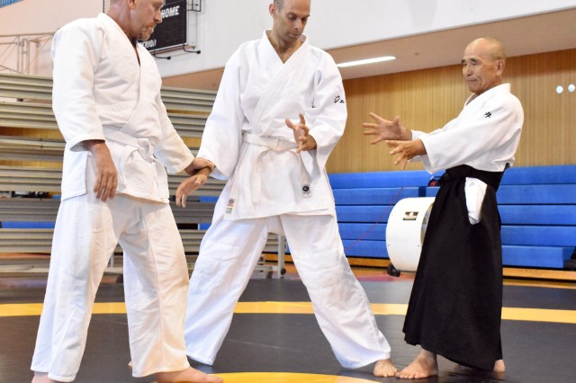 Yotaro Mukai, right, aikido sensei at the Yano Fitness Center, works with Geoff Ward, center, and Joe Millen during an aikido class at the Yano Fitness Center, Camp Zama, Japan, Aug. 8.