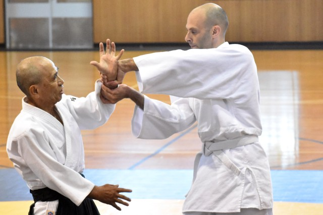 Yotaro Mukai, left, aikido sensei at the Yano Fitness Center, works with Geoff Ward, an engineer with the U.S. Army Corps of Engineers, Japan Engineer District, during an aikido class at the Yano Fitness Center, Camp Zama, Japan, Aug. 8.
