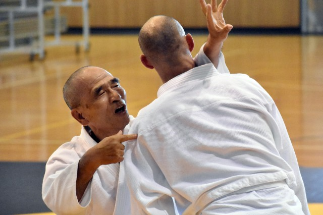 Yotaro Mukai, left, aikido sensei at the Yano Fitness Center, works with Geoff Ward, an architect at the U.S. Army Corps of Engineers, during an aikido class at the Yano Fitness Center, Camp Zama, Japan, Aug. 8.