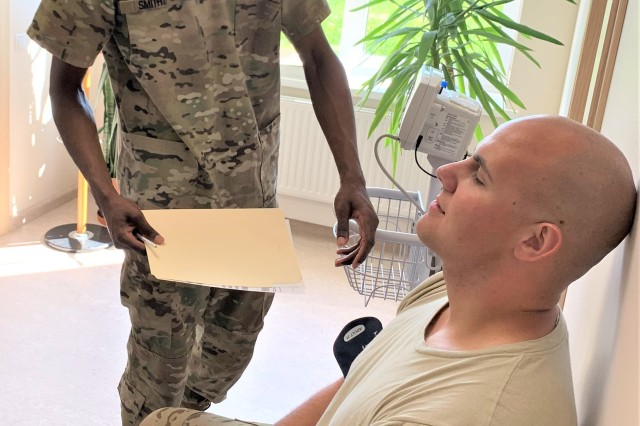 Pfc. Jah Mon Smith, a dental specialist assigned to the Hohenfels Army Dental Clinic in Germany, prepares a Soldier for a dental exam in Lielvarde, Latvia recently.  Smith was part of a team from Dental Health Command Europe who travelled to Latvia recently to provide dental support to members of the 1st Combat Aviation Brigade who are deployed on a nine-month rotation to Latvia as part of Operation Atlantic Resolve.