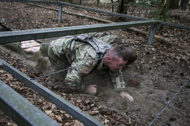 U.S. Army Staff Sgt. Joseph Coffey, operations noncommissioned officer, Troop Command, Landstuhl Regional Medical Center, and U.S. Army Sgt. 1st Class Christopher Moore, noncommissioned officer in charge, Troop Command, LRMC, negotiate an obstacle as part of the Litter Obstacle Course during LRMC's 2019 Best Medic competition, Aug. 6.
