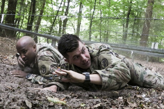 Staff Sgt. Paul Orndoff (right), noncommissioned officer in charge, Gastroenterology Clinic, negotiates an obstacle as part of the Litter Obstacle Course during LRMC's 2019 Best Medic competition, Aug. 6.