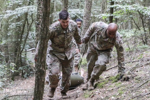 Staff Sgt. Paul Orndoff (left), noncommissioned officer in charge, Gastroenterology Clinic, negotiates an obstacle as part of the Litter Obstacle Course during LRMC's 2019 Best Medic competition, Aug. 6.