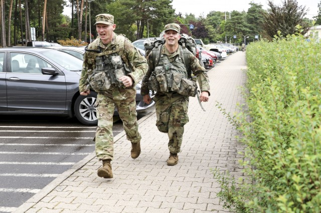 (From left) U.S. Army Staff Sgt. Joseph Coffey, operations noncommissioned officer, Troop Command, Landstuhl Regional Medical Center, and Staff Sgt. Paul Orndoff, noncommissioned officer in charge, Gastroenterology Clinic, conduct an integrated road march during LRMC's 2019 Best Medic competition, Aug. 6.