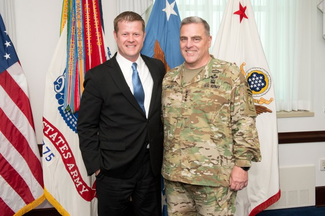 Acting Army Secretary Ryan D. McCarthy and Army Chief of Staff Gen. Mark A. Milley stand together in front of the Army colors, Sept. 5, 2017. The two men worked together through Milley's term as Army chief of staff.