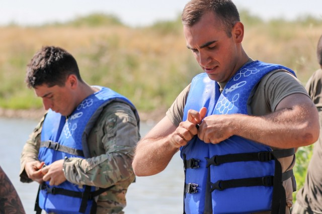 U.S. Army Cadet Kyle Summa, from U.S. Military Academy, puts on a safety vest, July 31, 2019, during Zodiac boat training with noncommissioned officers assigned to 2nd Battalion, 77th Field Artillery Regiment, 2nd Infantry Brigade Combat Team, 4th Infantry Division, during his Cadet Troop Leader Training (CTLT) rotation at Fort Carson, Colorado. (U.S. Army photo by Staff Sgt. Neysa Canfield)