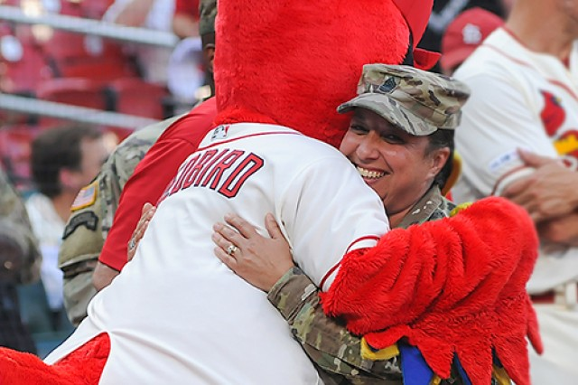 Sgt. Maj. Rebecca Franco, U.S. Army Chemical, Biological, Radiological and Nuclear School professional development sergeant major, gets a hug from Fredbird, the St. Louis Cardinals mascot, Saturday at Busch Stadium during Military Appreciation Day pre-game ceremonies.