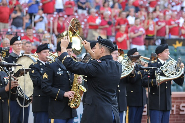 Warrant Officer Michael Becker directs Fort Leonard Wood's 399th Army Band as it plays the national anthem during pre-game ceremonies on Military Appreciation Day.