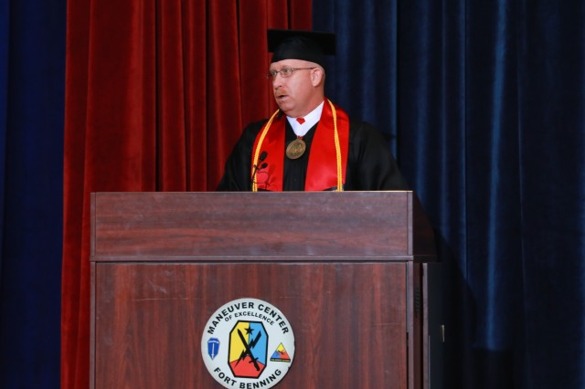 FORT BENNING, Ga. -- Master Gunnery Sgt. Steven Heath, the senior enlisted adviser for Marine Corps Detachment Fort Benning, speaks as student speaker during a graduation. Fort Benning graduates who finished their college degrees from different schools across the country during the 2018-2019 school year received their degrees during a ceremony here Aug. 9, 2019. (U.S. Army photo by Markeith Horace, Maneuver Center of Excellence, Fort Benning Public Affairs)