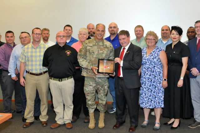 During a visit to Joint Munitions Command Headquarters August 13, Gen. Gus Perna, Commander, U.S. Army Materiel Command, presented the Department of the Army's Exceptional Organization Safety Award, which recognizes their staff's commitment of safety practices throughout the munitions enterprise. Pictured with Perna are headquarters safety personnel with safety officers representing JMC's subordinate arsenals, depots, ammunition plants and activities.