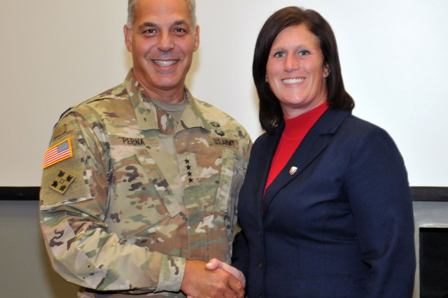 Gen. Gus Perna, Commander, U.S. Army Materiel Command, presented Jennifer Mulert, JMC Resource Management Directorate, with an AMC coin for her support in audit readiness, August 13.